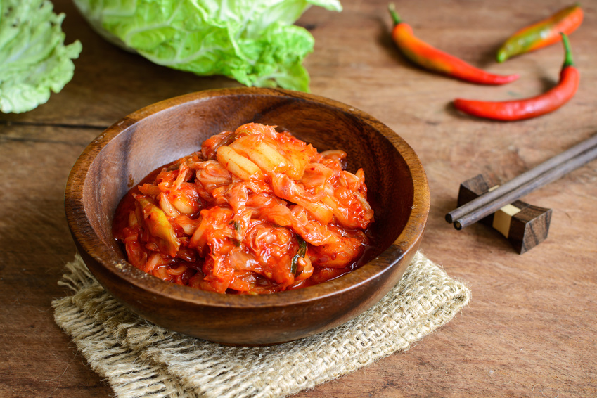 kimchi with Chopsticks on wooden table, korean traditional food