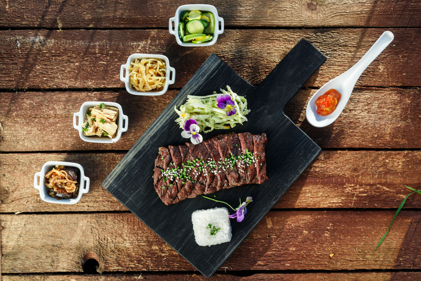 Korean BBQ with full side dishes on wooden background