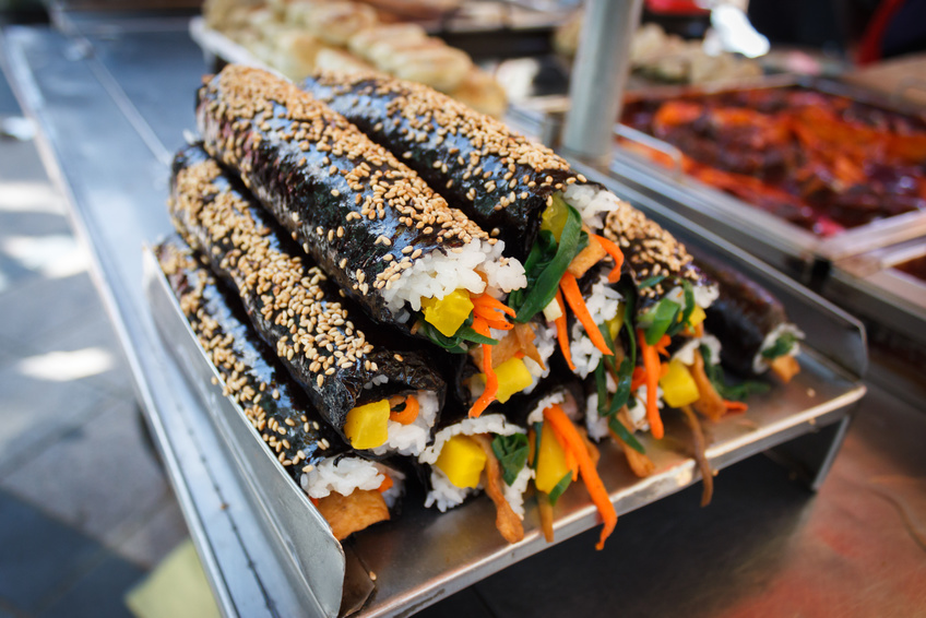 Street food for sale in Busan, Korea. Kimbap, also known as gimbap is very popular and similar to Japanese sushi but with a distinctive Korean taste. You'll know when you eat it.